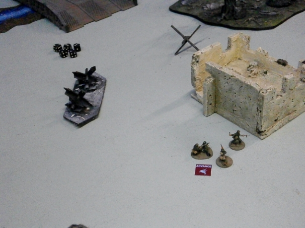 Across the way, the other infantry team attempt to get the MG-42 into cover.