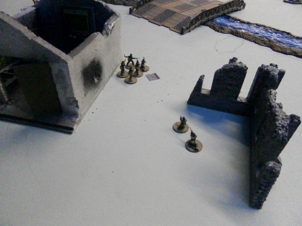 The German Kommandant follows behind his men at a safe distance.