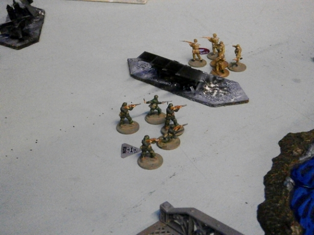 Another German team tackles the tank traps in an attempted pincer movement.